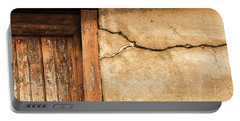 Cracked Lime Stone Wall And Detail Of An Old Wooden Door Portable Battery Charger by Semmick Photo