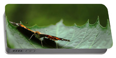 Portable Battery Charger featuring the photograph Cradled Painted Lady by Debbie Oppermann