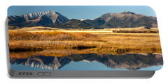 Portable Battery Charger featuring the photograph Crazy Mountain Reflections by Todd Klassy