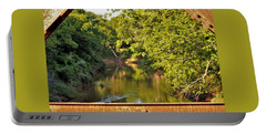 Portable Battery Charger featuring the photograph Creek View Through Bridge Trusses by Sheila Brown