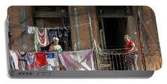Cuban Women Hanging Laundry In Havana Cuba Portable Battery Charger by Charles Harden