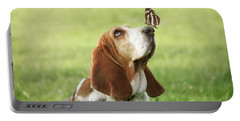 Cute Dog With Butterfly On His Nose Portable Battery Charger