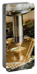 Portable Battery Charger featuring the photograph Cutting Brass by Bruce Carpenter