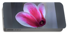 Portable Battery Charger featuring the photograph Cyclamen Portrait. by Terence Davis