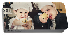 Dad And Son Cooks Shooting With Bananas In Kitchen Portable Battery Charger