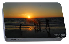 Portable Battery Charger featuring the photograph Dancing In The Sunset by Gary Wonning