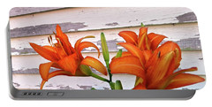 Portable Battery Charger featuring the photograph Day Lilies And Peeling Paint by Nancy Patterson