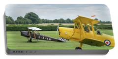 Portable Battery Charger featuring the photograph De Havilland Tiger Moths Taxiing by Gary Eason