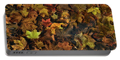 Decayed Autumn Leaves On The Ground Portable Battery Charger