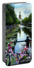 Portable Battery Charger featuring the photograph Canal And Decorated Bike In The Hague by RicardMN Photography