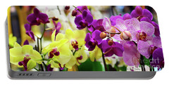 Portable Battery Charger featuring the photograph Decorative Orchids Still Life C82418 by Mas Art Studio