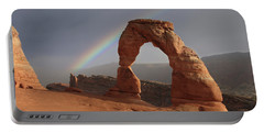 Portable Battery Charger featuring the photograph Delicate Arch And Rainbow by Marie Leslie