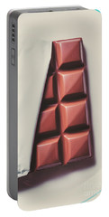 Delicious Chocolate Bar In Wrapping On Plate Portable Battery Charger