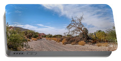 Portable Battery Charger featuring the photograph Desert Road by Arik Baltinester
