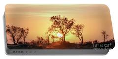 Portable Battery Charger featuring the photograph Desert Sunset by Arik Baltinester