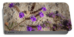 Portable Battery Charger featuring the photograph Desert Zig Zag Purple Flower by Penny Lisowski