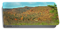 Portable Battery Charger featuring the photograph Devils Courthouse by Susan Leggett