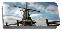 Dezwaan Windmill With Fence And Clouds Portable Battery Charger