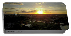 Portable Battery Charger featuring the photograph Disney Sunset by Michael Albright