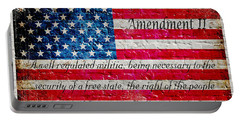 Distressed American Flag And Second Amendment On White Bricks Wall Portable Battery Charger