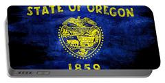 Distressed Oregon Flag On Black Portable Battery Charger by Jon Neidert