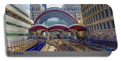 Dlr Canary Wharf And Approaching Train Portable Battery Charger by Venetia Featherstone-Witty