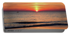 Portable Battery Charger featuring the photograph Dolphin Jumping In The Sunrise by Nicole Lloyd