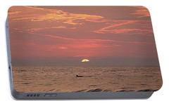 Portable Battery Charger featuring the photograph Dolphin Swims At Sunrise by Robert Banach