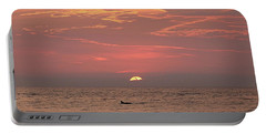 Dolphin Swims At Sunrise Portable Battery Charger by Robert Banach
