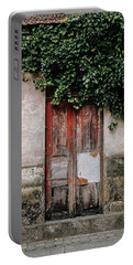 Portable Battery Charger featuring the photograph Door Covered With Ivy by Marco Oliveira