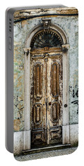 Door No 35 Portable Battery Charger by Marco Oliveira