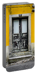 Door No 37 Portable Battery Charger by Marco Oliveira
