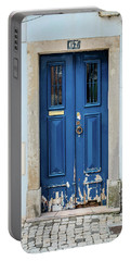 Door No 67 Portable Battery Charger by Marco Oliveira