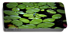 Dragonfly Among The Lily Pads Portable Battery Charger by Tara Potts
