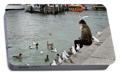 Portable Battery Charger featuring the photograph Dreadlocks Man Feeding Birds by Yurix Sardinelly