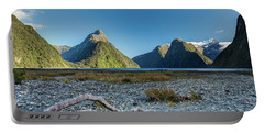 Portable Battery Charger featuring the photograph Driftwood In Milford Sound by Gary Eason