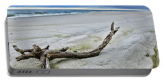 Portable Battery Charger featuring the photograph Driftwood On The Beach by Paul Ward