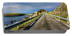 Portable Battery Charger featuring the photograph Driving Along The Norwegian Sea by Dmytro Korol