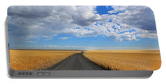 Portable Battery Charger featuring the photograph Driving Through The Wheat Fields by Lynn Hopwood