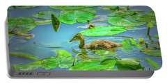 Portable Battery Charger featuring the photograph Duckling In The Green. by Leif Sohlman