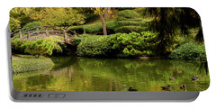 Portable Battery Charger featuring the photograph Ducks In Summertime by Iris Greenwell