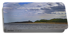 Portable Battery Charger featuring the photograph Dunstanburgh Castle  by Tony Murtagh