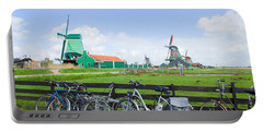 dutch windmills with bikes in Zaanse Schans Portable Battery Charger by Anastasy Yarmolovich