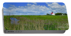 East Point Lighthouse Across The Marsh  Portable Battery Charger by Nancy Patterson