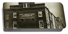 Portable Battery Charger featuring the photograph Eat Berthas Mussels In Black And White by Paul Ward