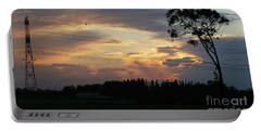 Portable Battery Charger featuring the photograph Electrified Sunset by Arik Baltinester
