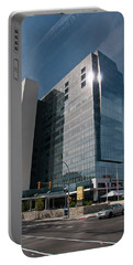 Portable Battery Charger featuring the photograph Embassy Suites 2916 by Guy Whiteley
