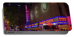Portable Battery Charger featuring the photograph Emergency At Radio City by RKAB Works