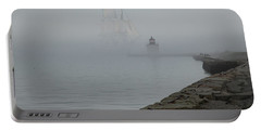 Portable Battery Charger featuring the photograph Emerging From The Fog by Jeff Folger