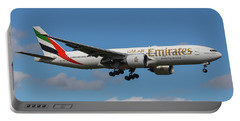 Portable Battery Charger featuring the photograph Emirates Air 777 by Dart Humeston